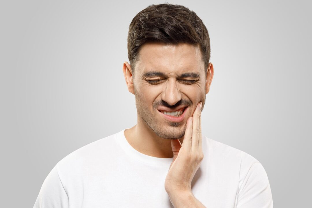 How do I alleviate tooth pain at home?