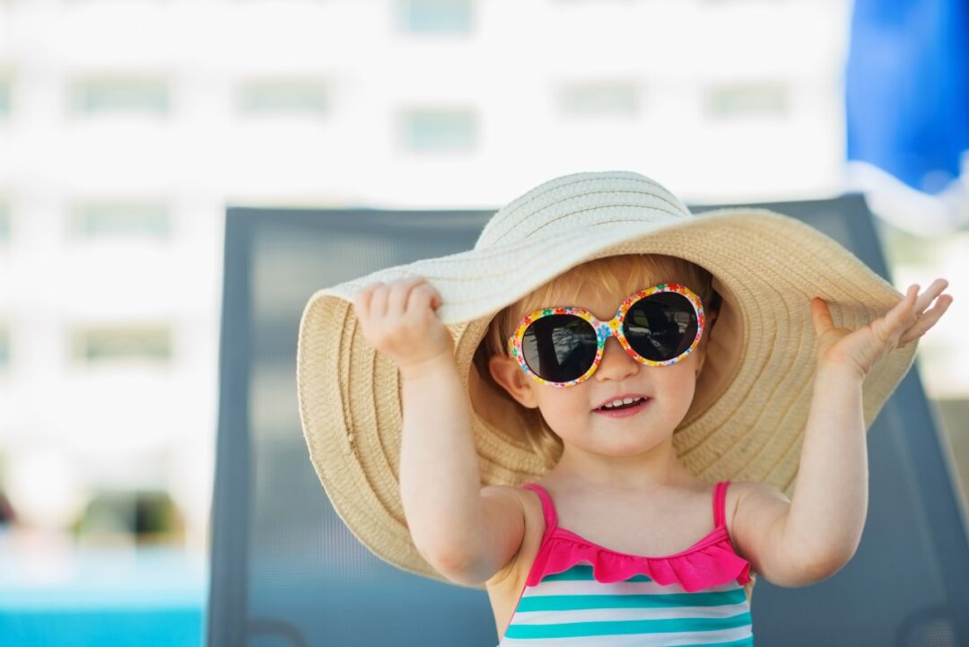 How should children be protected from the sun?